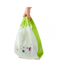 Pikmin 3 Deluxe Reusable Bag Being Held By The Handles